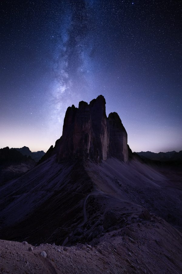 stars and milky way over three peaks in italian dolomites