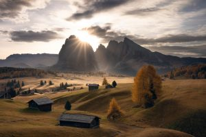 sun rays on the alpe di siusi in the dolomites