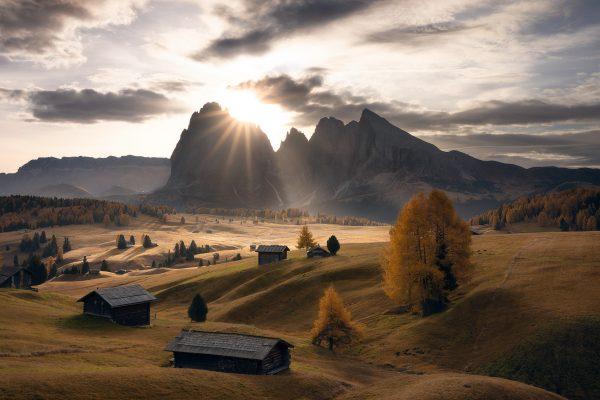 sun rays on the alpe di siusi in the dolomites