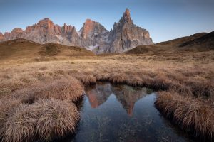 mountain in the dolomites reflected in pond