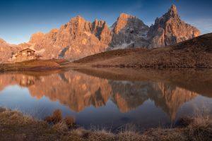 palle di san martino mountains reflect in a pond