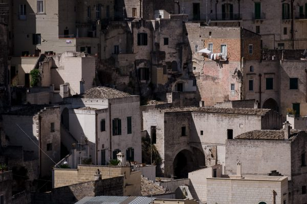 Laundry hangs from a window in one of the many buildings built on top of one another in the historic Sassi di Matera, Italy.