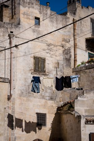 Laundry hangs from the side of an old building in the UNESCO World Heritage site of Matera, Italy.