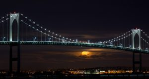 A super moon rises behind the Newport Pell Bridge in Rhode Island