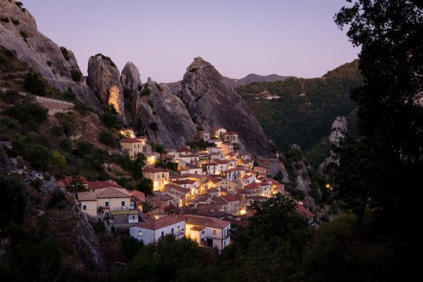 The town of Castelmezzano, Italy lit up during the blue hour.