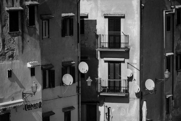 A black and white travel photograph of the houses in Vieste, Italy.