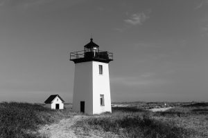 A black and white image of woods end light in Provincetown, MA