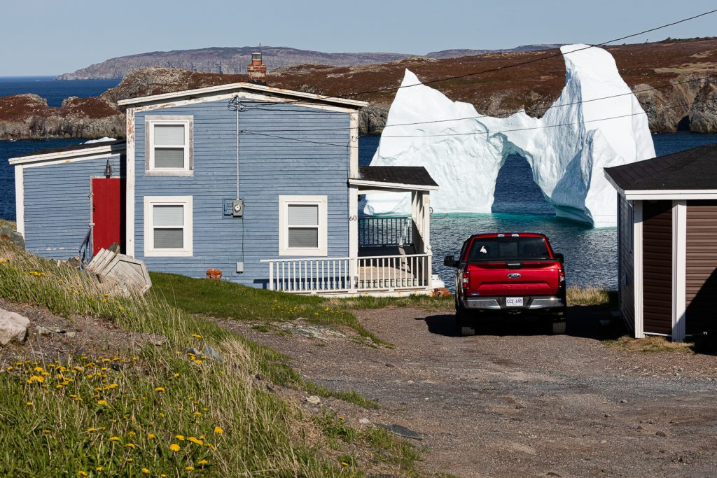 A photo of an iceberg in someone's backyard in grates cove newfoundland