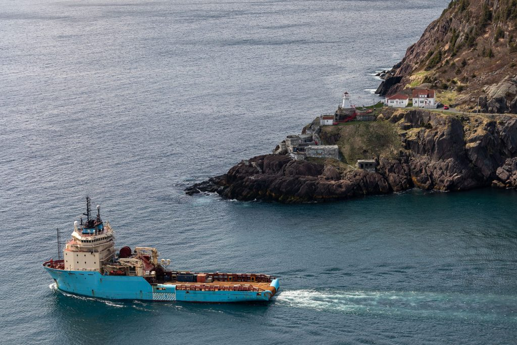 Photo of a freight boat passing Fort Amherst in St. John's newfoundland