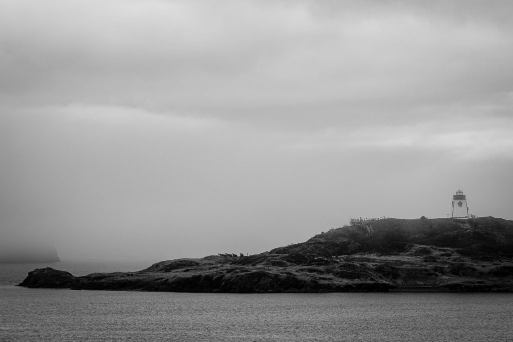 A photo of fog and a small lighthouse in Trinity Newfoundland