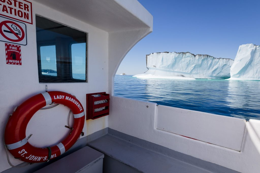 Bonavista puffin and whale tours boat passed an iceberg in iceberg alley newfoundland