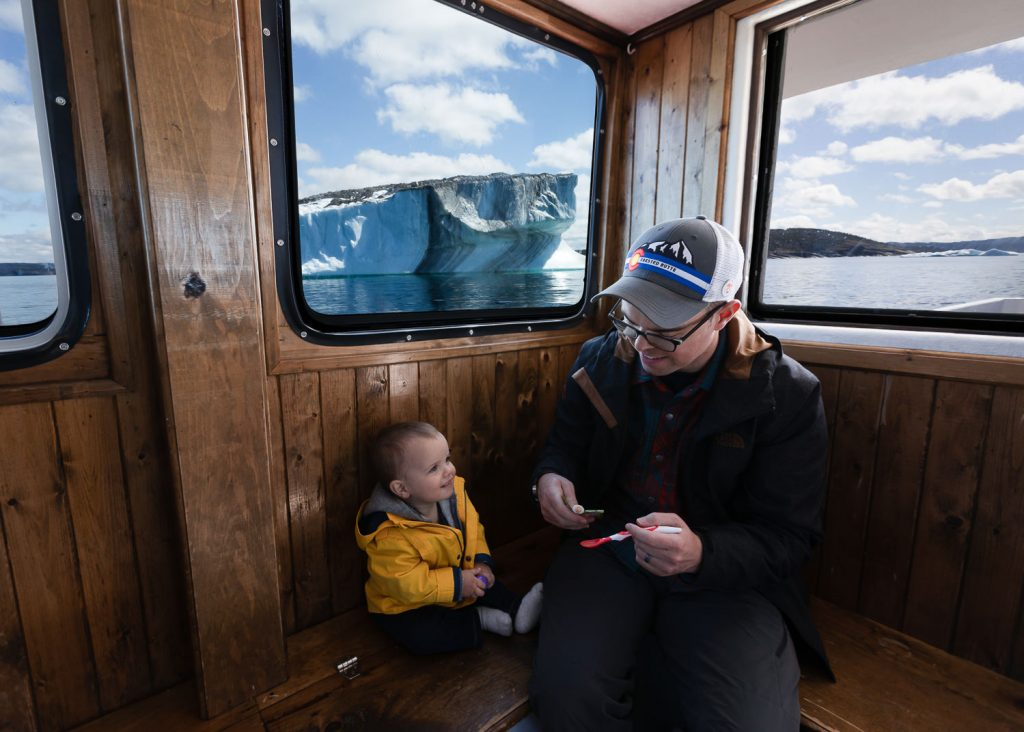 A dad and baby aboard Bonavista Puffin and Whale Tours boat in Iceberg Alley newfoundland