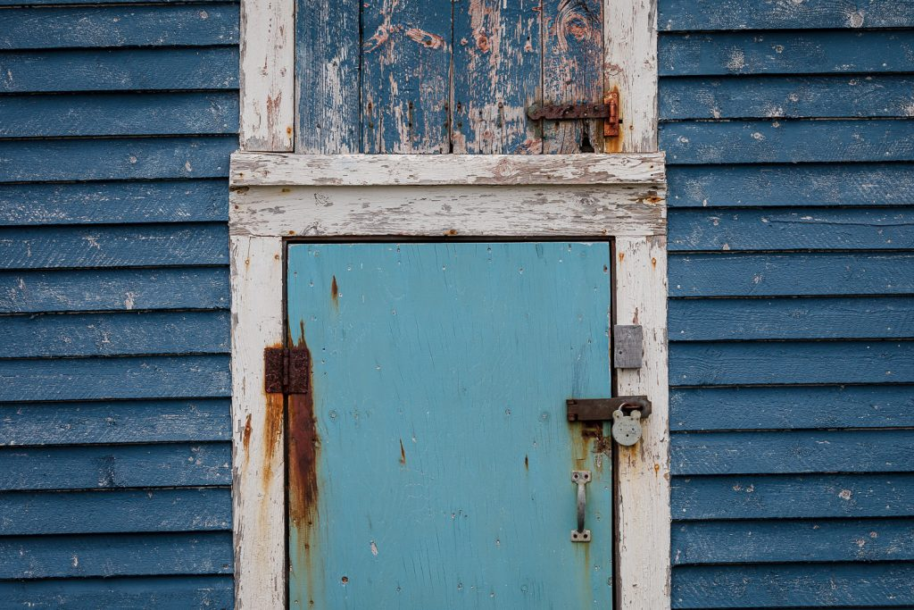 An old blue door in Twillingate Newfoundland canada