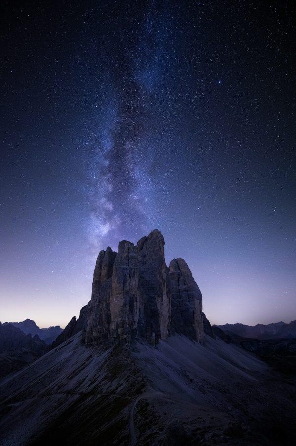 milky way and stars at tre cime di laverado in the dolomites